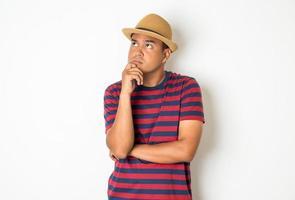 Thinking man on white background photo