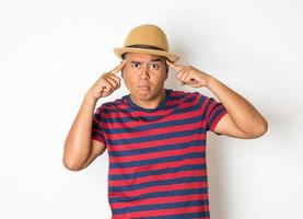 Confused man on white background photo