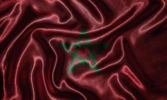 papel pintado de la bandera de Marruecos y bandera ondeando por la tela. foto
