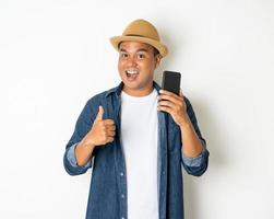 Man with phone on white background photo