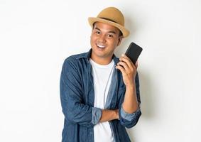 Happy man holding phone photo