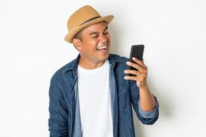 Happy man using phone photo