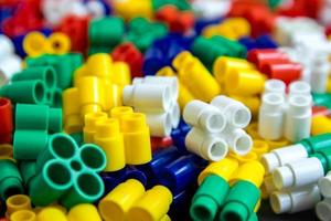 Multicolored plastic building blocks as a background texture photo