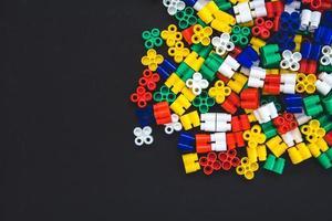 Multicolored plastic blocks on a black background photo