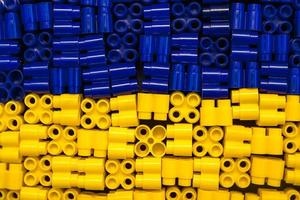 Plastic bricks are yellow and blue as a background texture photo