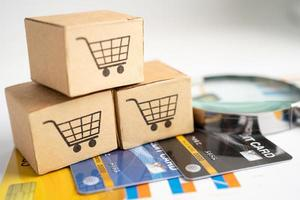 Shopping cart logo on box with credit card photo
