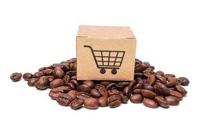 Shopping cart on coffee beans, Import Export commerce online photo