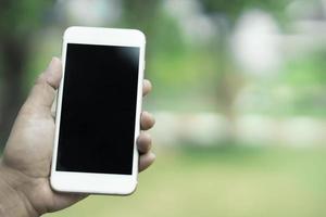 Holding mobile phone technology photo