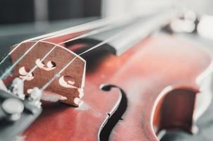 The violin on table, Classic musical instrument used in the orchestra. photo