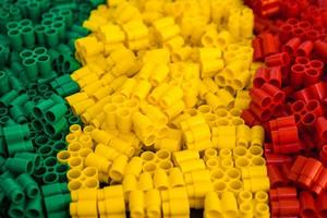 Plastic bricks of red, yellow and green as a background texture photo