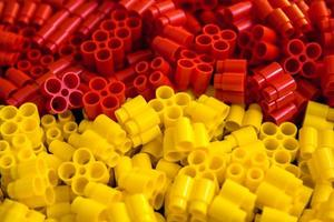 Plastic bricks of yellow and red on a background photo
