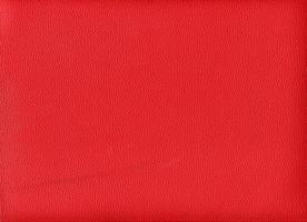 Fondo de textura de cuero sintético rojo burdeos foto