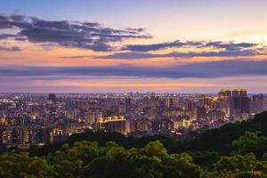 View over Taoyuan City from Hutou mountain in Taiwan at night photo