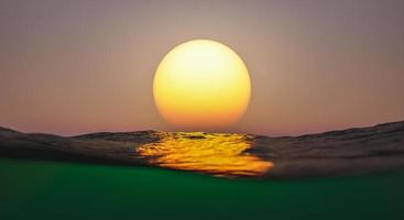 Sunset over the surface of the sea photo