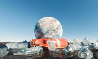 Planet with lifebuoy in the ocean surrounded by plastic bottles photo