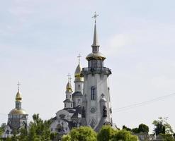 Christian church cross in high steeple tower for prayer photo