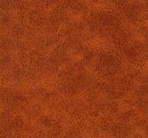 Fondo de textura de piel sintética de imitación de cuero marrón foto