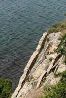 Rapid cliff above the sea photo