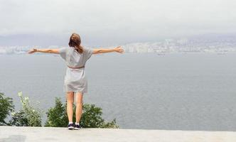 Back view of young woman looking at the cityscape photo