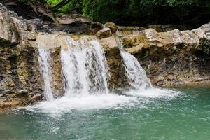 Beautiful tropical waterfall photo