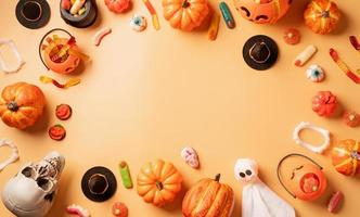 Halloween holiday decorations with pumpkins and candies top view photo
