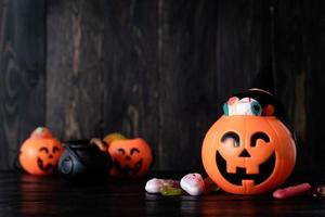 Halloween backgound with jack o lanterns pumpkins with sweets photo