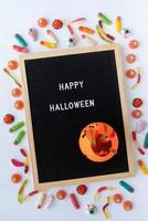 Halloween holiday sweets with black letter board photo