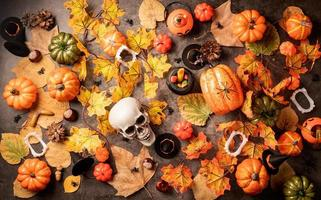 Halloween holiday decorations with pumpkins and candies photo