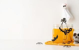 Scary Halloween cocktails with party decorations on white background photo