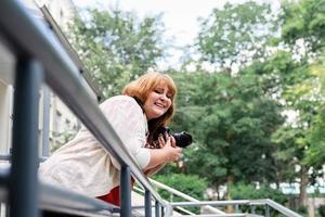 Plus size woman photographer outdoors photo