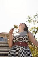 Portrait of laughing woman holding a bouquet of flowers photo