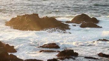 Extreme wave crushing coast at a sea shore. video