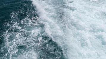 Wake and splashing waters of a motorboat in super slow motion video