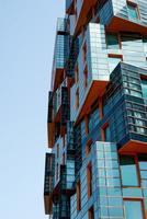 The modern apartment building in futuristic style photo