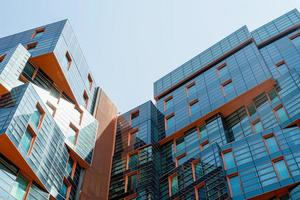 Modern apartment or office building with glass walls in city center photo