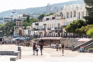Yalta, Crimea 2021- Embankment with people on the Black Sea coast photo
