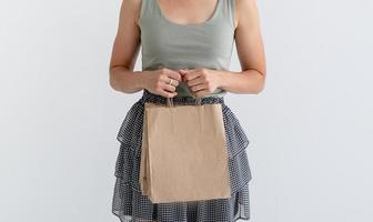 Woman holding eco friendly shopping bags photo