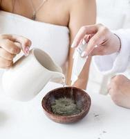 Women's hands making facial mask doing spa procedures photo