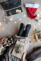 Top view of woman with her dog shopping online at Christmas holidays photo