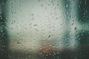 Background and wallpaper by rainy drop and water drops on window. photo