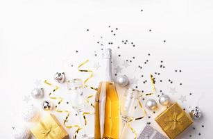 Christmas and New Year party decorations with confetti and gift photo