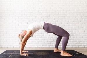 Young attractive woman practicing yoga, wearing sportswear photo