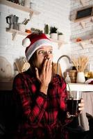 Woman in 3D glasses watching movies at home at night at Christmas photo