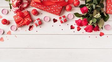 Red roses and Valentine's Day decorations, top view photo