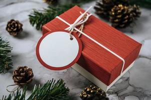 Gift boxes with small gifts on white cement photo