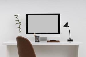 High angle desk arrangement with laptop photo