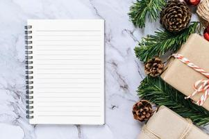 A notebook placed on a cement background with gifts photo
