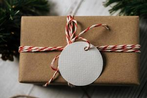 Gift box with a small gift on a white wooden background photo