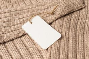 Brown sweater with clear tag photo