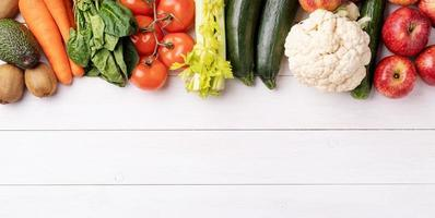 Top view of healthy food on white wooden background photo